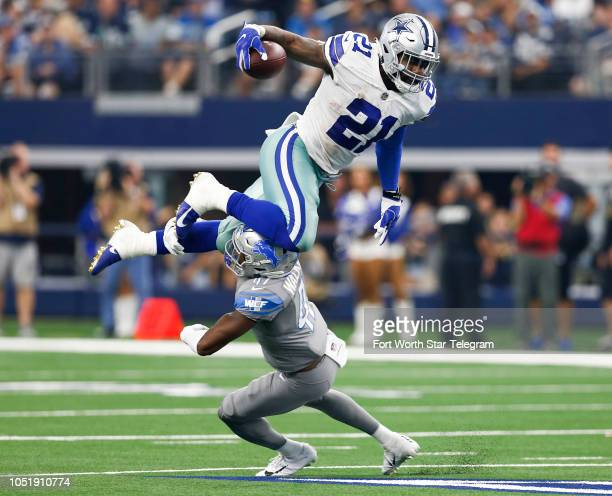 Dallas Cowboys running back Ezekiel Elliott leaps over Detroit Lions defensive back Tracy Walker during the second half on Sunday Sept 30 2018 at ATT...