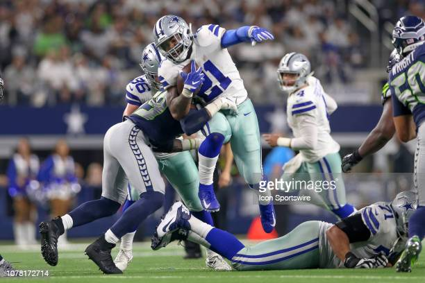 Dallas Cowboys running back Ezekiel Elliott leaps over offensive tackle La'el Collins during the NFC wildcard playoff game between the Seattle...
