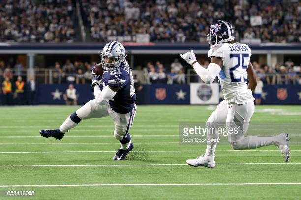 Dallas Cowboys running back Ezekiel Elliott makes a reception with Tennessee Titans cornerback Adoree' Jackson defending during the game between the...