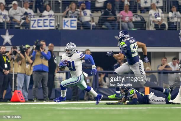 Dallas Cowboys running back Ezekiel Elliott runs around the edge with Seattle Seahawks strong safety Bradley McDougald and outside linebacker KJ...