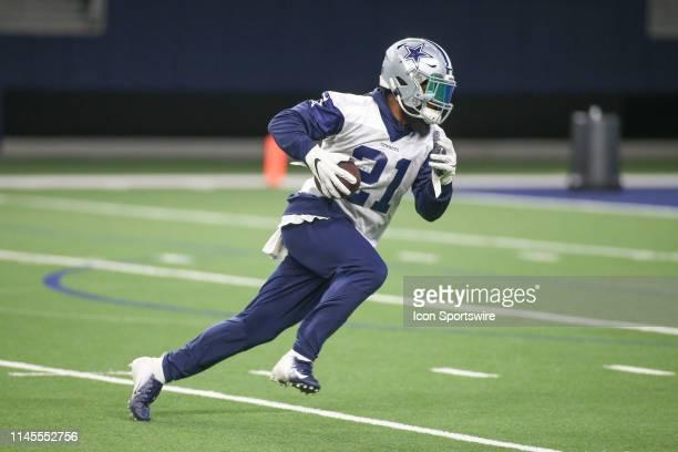 Dallas Cowboys running back Ezekiel Elliott runs up the field during the Dallas Cowboys OTA on May 22 2019 at The Star in Frisco TX