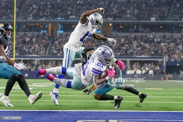 Dallas Cowboys running back Ezekiel Elliott rushes for a touchdown during the game between the Jacksonville Jaguars and Dallas Cowboys on October 14...