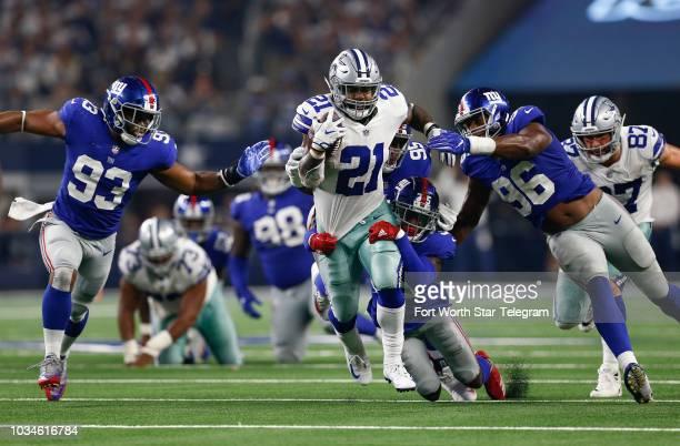 Dallas Cowboys running back Ezekiel Elliott rushes past New York Giants cornerback Curtis Riley linebacker BJ Goodson and linebacker Kareem Martin...