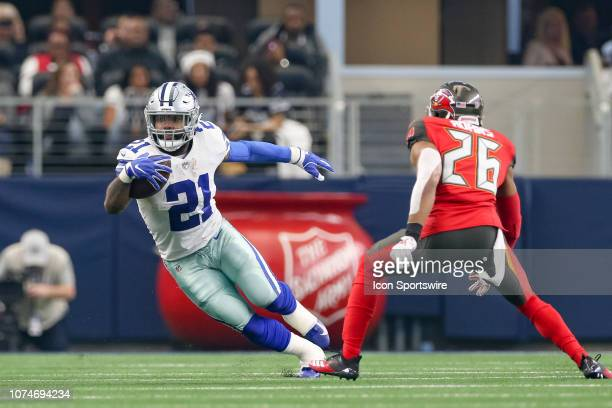 Dallas Cowboys Running Back Ezekiel Elliott rushes with the ball during the game between the Dallas Cowboys and Tampa Bay Buccaneers on December 23,...