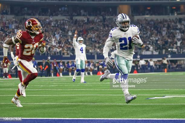 Dallas Cowboys Running Back Ezekiel Elliott scores a touchdown during the Thanksgiving Day game between the Washington Redskins and Dallas Cowboys on...