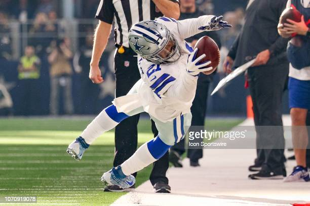 Dallas Cowboys Running Back Ezekiel Elliott stretches after making a sideline reception during the game between the Philadelphia Eagles and Dallas...