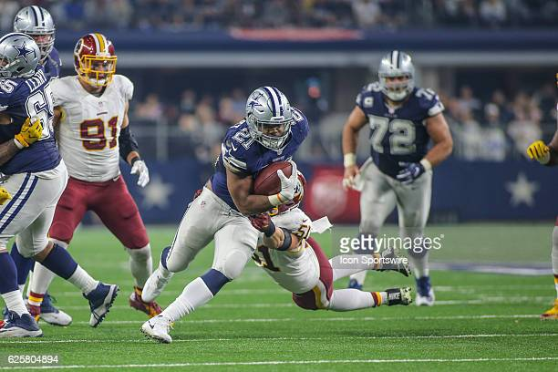 Dallas Cowboys Running Back Ezekiel Elliott tries to avoid a tackle by Washington Redskins Linebacker Will Compton during the NFL game between the...