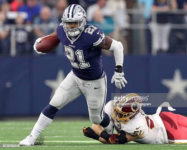 Dallas Cowboys running back Ezekiel Elliott tries to break free from Washington Redskins linebacker Will Compton during the first half on Thursday,...