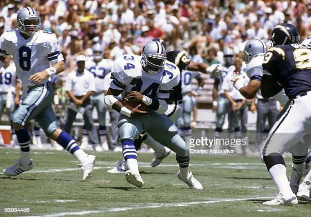 Dallas Cowboys running back Herschel Walker carries the ball and looks for room to run during the Cowboys 203 preseason victory over the San Diego...