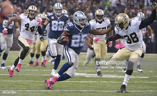 Dallas Cowboys running back Lance Dunbar eludes New Orleans Saints free safety Kenny Phillips on Sunday Oct 4 at the MercedesBenz Superdome in New...