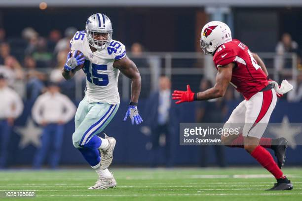 Dallas Cowboys running back Rod Smith is chased by Arizona Cardinals defensive back Antoine Bethea during the preseason football game between the...