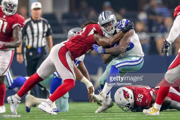 Dallas Cowboys running back Rod Smith is tackled by Arizona Cardinals linebacker Josh Bynes during the preseason football game between the Dallas...