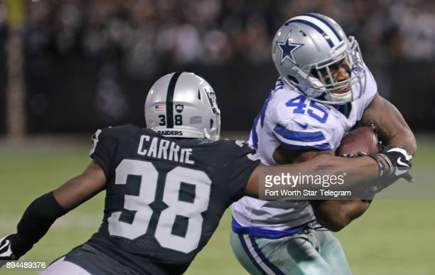 Dallas Cowboys running back Rod Smith takes a reception for a first down in the first quarter as Oakland Raiders cornerback TJ Carrie attempts the...