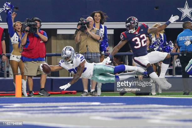 Dallas Cowboys running back Tony Pollard dives for the endzone with Houston Texans cornerback Lonnie Johnson defending during the preseason game...
