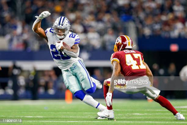 Dallas Cowboys Running Back Tony Pollard rushes by Washington Redskins Cornerback Aaron Colvin during the NFC East game between the Dallas Cowboys...