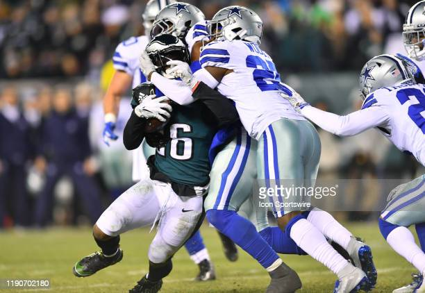 Dallas Cowboys Safety Xavier Woods and Dallas Cowboys Linebacker Jaylon Smith tackle Philadelphia Eagles Running Back Miles Sanders in the second...