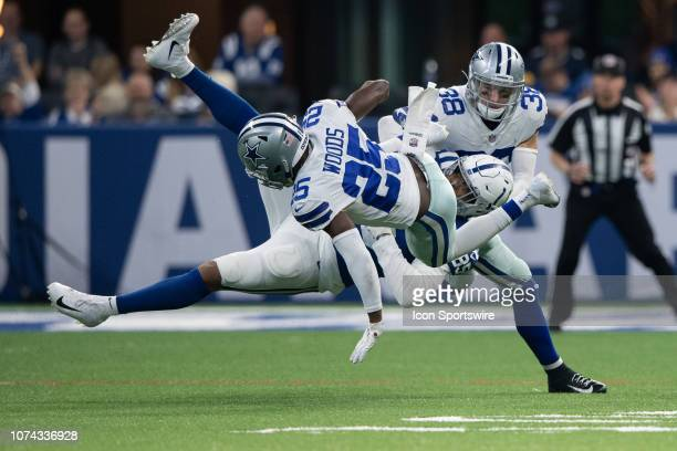 Dallas Cowboys safety Xavier Woods and Dallas Cowboys safety Jeff Heath break up a pass intended for Indianapolis Colts tight end Eric Ebron during...