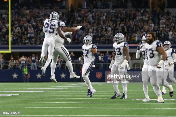 Dallas Cowboys Safety Xavier Woods celebrates with Defensive Tackle Antwaun Woods after stopping the New Orleans Saints on short of the goal line on...