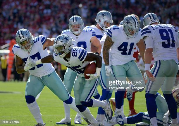 Dallas Cowboys safety Xavier Woods comes up with the fumble recovery on a punt return during the first quarter as the Cowboys beat the San Francisco...