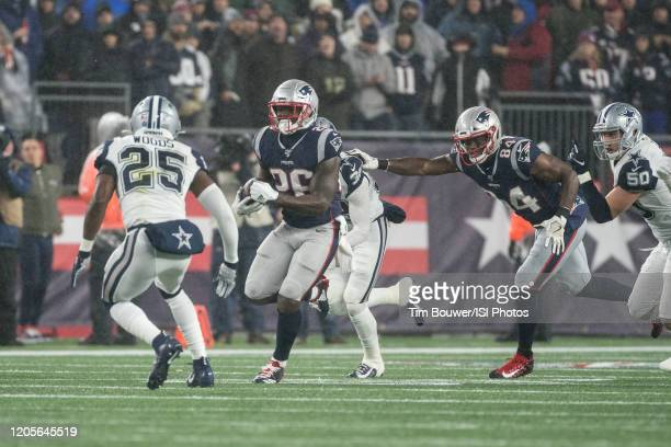 Dallas Cowboys Safety Xavier Woods prepares to tackle New England Patriots Running Back Sony Michel during a game between Dallas Cowboys and New...