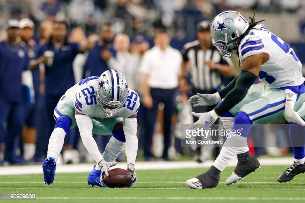 Dallas Cowboys Safety Xavier Woods recovers a fumble during the NFC East game between the Dallas Cowboys and Washington Redskins on December 29, 2019...