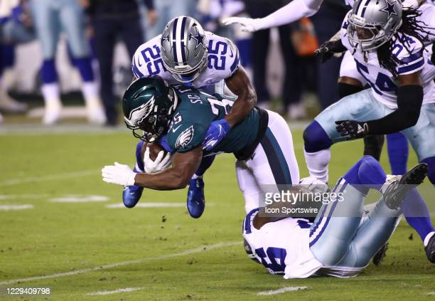 Dallas Cowboys Safety Xavier Woods tackles Philadelphia Eagles Running Back Boston Scott in the first half during the game between the Dallas Cowboys...