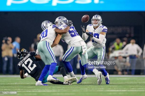 Dallas Cowboys strong safety Jeff Heath makes an interception during the game between the Jacksonville Jaguars and Dallas Cowboys on October 14 2018...