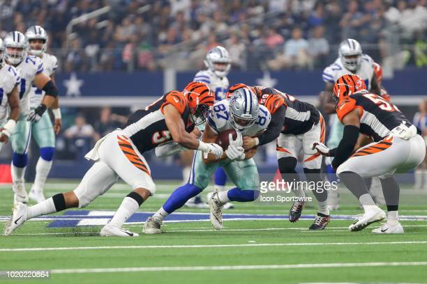 Dallas Cowboys tight end Geoff Swaim catches a pass and gets tackled by Cincinnati Bengals linebacker Nick Vigil during the game between the Dallas...