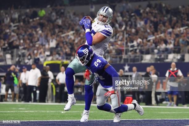 Dallas Cowboys tight end Jason Witten catches a touchdown pass with New York Giants cornerback Eli Apple defending during the Sunday Night NFL game...