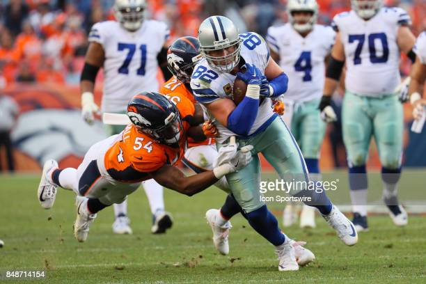 Dallas Cowboys tight end Jason Witten is tackled by Denver Broncos inside linebacker Brandon Marshall and cornerback Aqib Talib during a game between...
