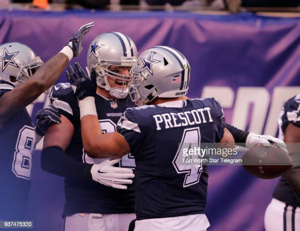 Dallas Cowboys tight end Jason Witten middle is congratulated by quarterback Das Prescott after a touchdown catch against the New York Giants on...