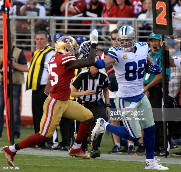Dallas Cowboys tight end Jason Witten picks up a first down as San Francisco 49ers free safety Jimmie Ward runs him out of bounds during the third...