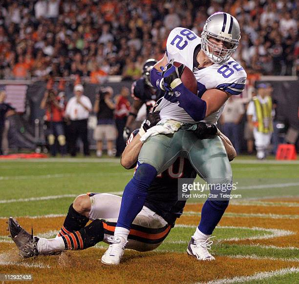 Dallas Cowboys tight end Jason Witten scores a touchdown with Chicago Bears safety Adam Archuleta hanging during game action at Soldier Field in...