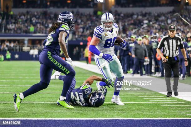 Dallas Cowboys tight end Jason Witten tries to stiff arm Seattle Seahawks safety Earl Thomas as cornerback Shaquill Griffin comes in to help during...