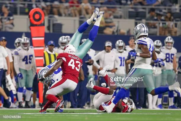 Dallas Cowboys tight end Rico Gathers flips after making a reception during the preseason football game between the Dallas Cowboys and Arizona...