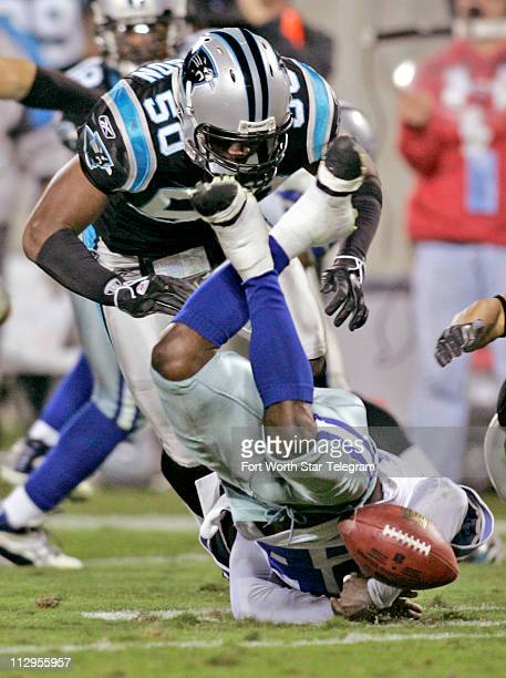 Dallas Cowboys' Tyson Thompson loses the ball in front Carolina Panthers' James Anderson at Bank of America Stadium in Charlotte North Carolina...