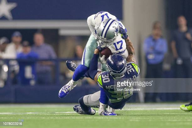 Dallas Cowboys wide receiver Allen Hurns is injured on a tackle by Seattle Seahawks strong safety Bradley McDougald during the NFC wildcard playoff...