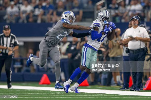 Dallas Cowboys wide receiver Allen Hurns makes a reception with Detroit Lions defensive back Darius Slay defending during the game between the...