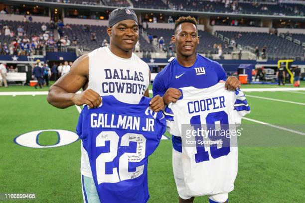 Dallas Cowboys Wide Receiver Amari Cooper and New York Giants Running Back Wayne Gallman exchange jerseys after the game between the New York Giants...