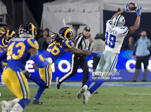 Dallas Cowboys wide receiver Amari Cooper can't come down with a pass from quarterback Dak Prescott during the second quarter against the Los Angeles...