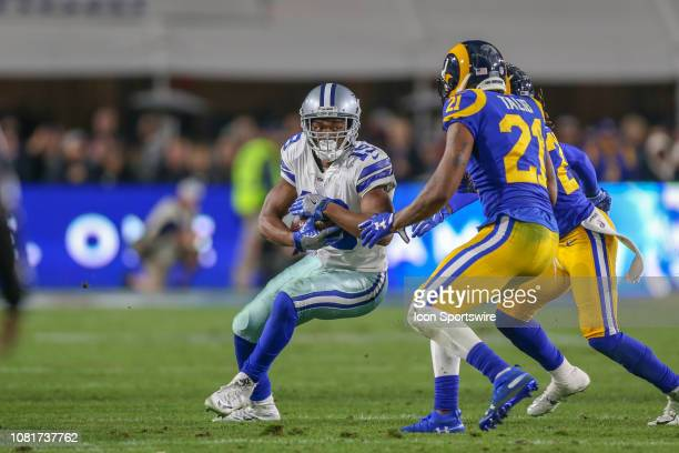 Dallas Cowboys wide receiver Amari Cooper catches the ball for a gain during the NFC Divisional Football game between the Dallas Cowboys and the Los...