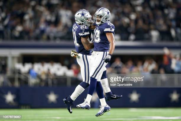 Dallas Cowboys wide receiver Amari Cooper celebrates his touchdown with running back Ezekiel Elliott during the game between the Tennessee Titans and...
