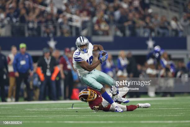 Dallas Cowboys Wide Receiver Amari Cooper is tackled by Washington Redskins Cornerback Josh Norman after making a reception during the Thanksgiving...