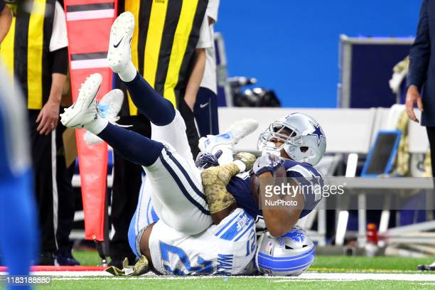 Dallas Cowboys wide receiver Amari Cooper is taken down by Detroit Lions defensive back Tracy Walker during the first half of an NFL football game...