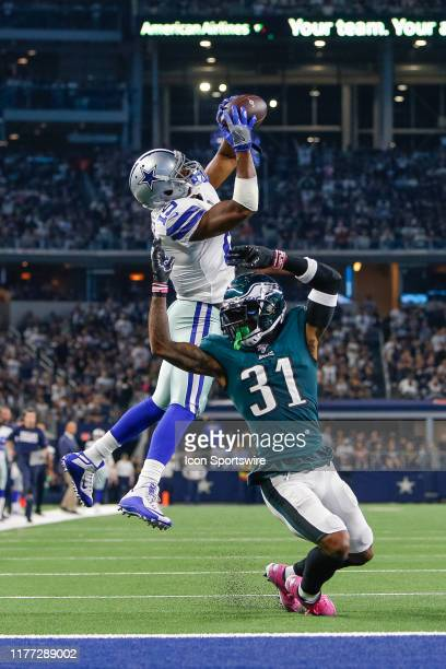 Dallas Cowboys Wide Receiver Amari Cooper makes a catch over Philadelphia Eagles Cornerback Jalen Mills for what appears to be a touchdown but is...