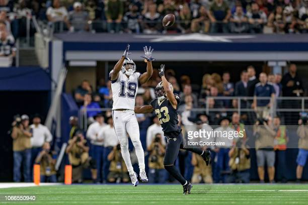 Dallas Cowboys Wide Receiver Amari Cooper makes a reception over New Orleans Saints Cornerback Marshon Lattimore during the game between the Dallas...