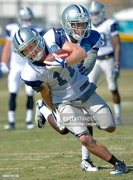Dallas Cowboys wide receiver Cole Beasley catches the ball in front of cornerback Anthony Brown during an afternoon practice at training camp in...