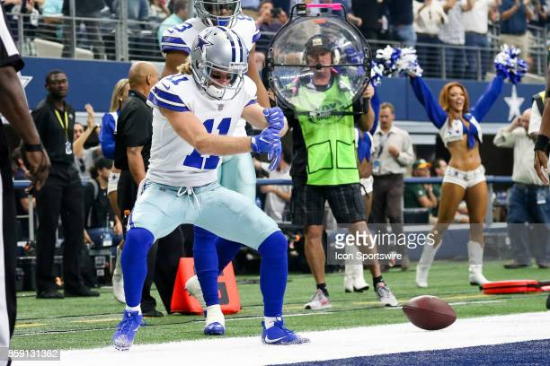 Dallas Cowboys wide receiver Cole Beasley celebrates after scoring a touchdown during the football game between the Green Bay Packers and Dallas...