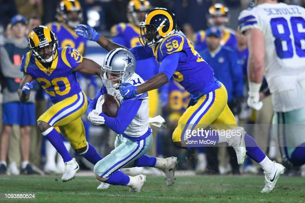 Dallas Cowboys wide receiver Cole Beasley is brought down by Cory Littleton as Lamarcus Joyner looks on at Los Angeles Memorial Coliseum on January...