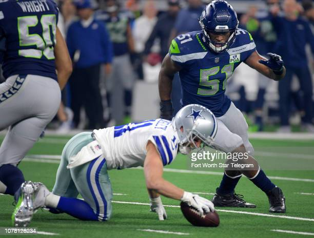 Dallas Cowboys wide receiver Cole Beasley is injured during the first quarter against the Seattle Seahawks in an NFL Wild Card playoff game at ATT...